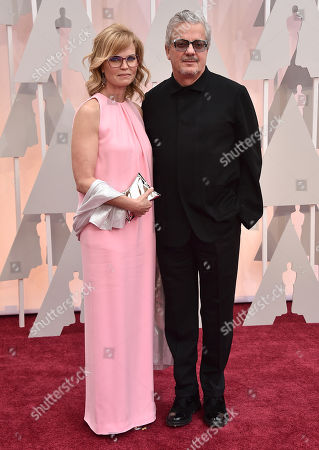 Mark Mothersbaugh, right, and Anita Greenspan arrive at the Oscars, at the Dolby Theatre in Los Angeles