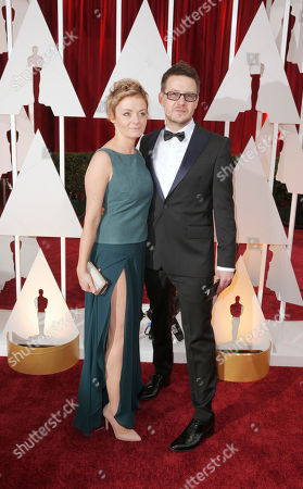 Agata Trzebuchowska, left, and Pawel Pawlikowski arrive at the Oscars, at the Dolby Theatre in Los Angeles