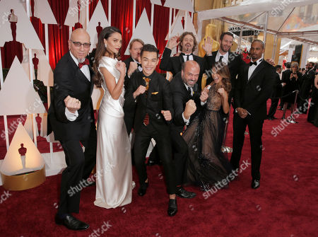 Roy Conli, from left, Genesis Rodriguez, Don Hall, Ryan Potter, Scott Adsit,T.J. Miller, Jamie Chung, Chris Williams, and Damon Wayans Jr. arrive at the Oscars, at the Dolby Theatre in Los Angeles