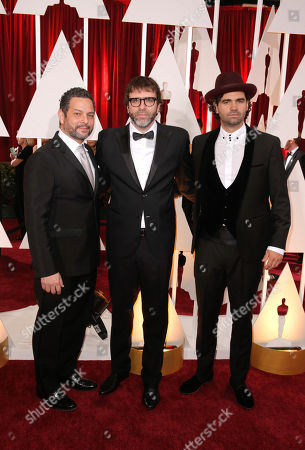 Alexander Dinelaris Jr, from left, Nicolás Giacobone, and Armando Bo arrive at the Oscars, at the Dolby Theatre in Los Angeles
