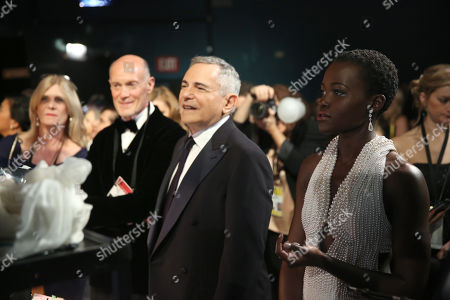 Show Producer Neil Meron, and from left, Show Producer Craig Zadan and Lupita Nyong'o are seen backstage at the Oscars, at the Dolby Theatre in Los Angeles