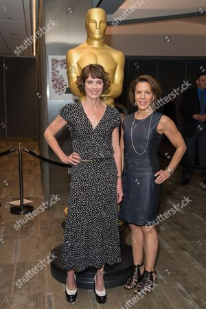 """Dana Perry, left, and Ellen Goosenberg Kent arrive at the 87th Academy Awards - """"Documentaries"""" at the Samuel Goldwyn Theatre on in Beverly Hills, Calif"""