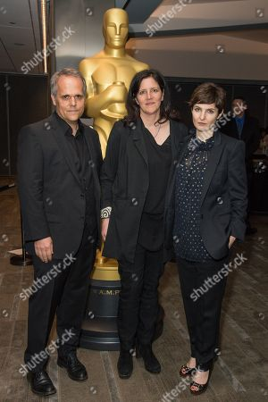 """Dirk Wilutzky, left, Laura Poitras and Mathilde Bonnefoy arrive at the 87th Academy Awards - """"Documentaries"""" at the Samuel Goldwyn Theatre on in Beverly Hills, Calif"""