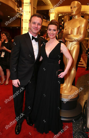 Sean Bailey, President, Walt Disney Studios Motion Picture Production, left, and Charmaine Bailey arrive at the Oscars, at the Dolby Theatre in Los Angeles