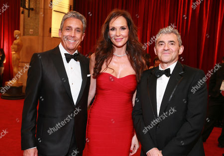 Stock Image of Charles S. Cohen, CEO and Chairman of Cohen Media Group, from left, Chloe Cohen and Daniel Battsek, President of Cohen Media Group arrive at the Oscars, at the Dolby Theatre in Los Angeles