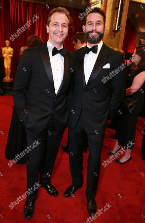 Radius-TWC co-presidents Tom Quinn, left, and Jason Janego arrive at the Oscars, at the Dolby Theatre in Los Angeles
