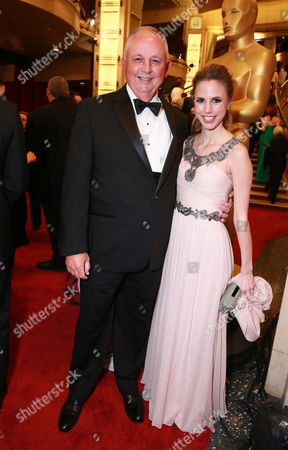 Dick Cook, left, and Roxanne Cook arrives at the Oscars, at the Dolby Theatre in Los Angeles