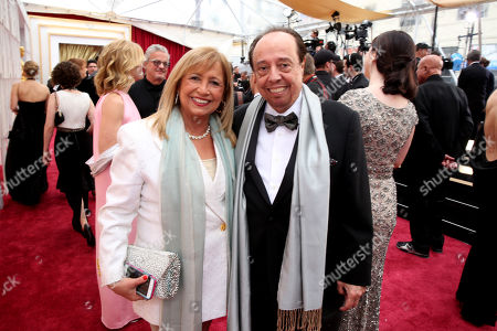 Gracinha Mendes, left, and Sergio Mendes arrive at the Oscars, at the Dolby Theatre in Los Angeles