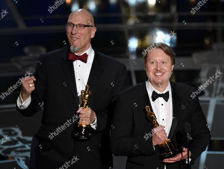 Roy Conli, left, and Don Hall accept the award for best animated feature film for Big Hero 6 at the Oscars, at the Dolby Theatre in Los Angeles