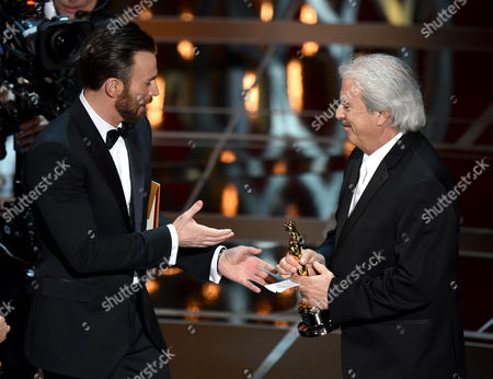 Chris Evans, left, presents Alan Robert Murray with the award for best sound editing for American Sniper at the Oscars, at the Dolby Theatre in Los Angeles