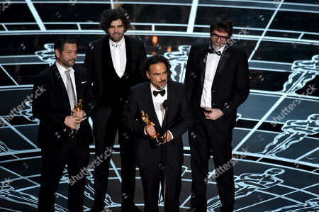 Alexander Dinelaris, from left, Armando Bo, Alejandro G. Inarritu, and Nicolas Giacobone accept the award for the best original screenplay for Birdman or (The Unexpected Virtue of Ignorance) at the Oscars, at the Dolby Theatre in Los Angeles