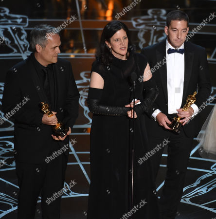 Dirk Wilutzky, from left, Laura Poitras and Glenn Greenwald accept the award for best documentary feature for Citizenfour at the Oscars, at the Dolby Theatre in Los Angeles