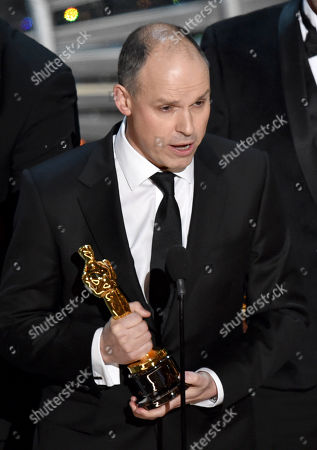 Stock Image of Paul Franklin accepts the award for best visual effects for Interstellar at the Oscars, at the Dolby Theatre in Los Angeles
