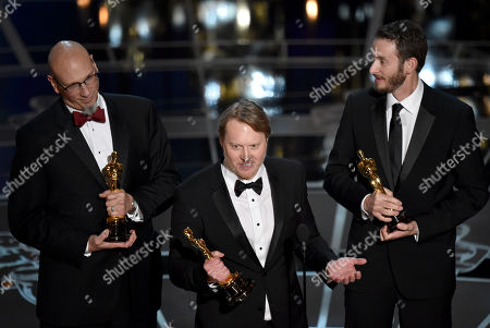 Roy Conli, from left, Don Hall, and Chris Williams accept the award for best animated feature film for Big Hero 6 at the Oscars, at the Dolby Theatre in Los Angeles