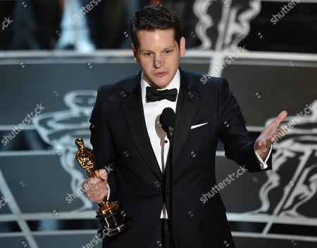 Graham Moore accepts the award for the best adapted screenplay for The Imitation Game at the Oscars, at the Dolby Theatre in Los Angeles
