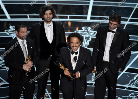 Alexander Dinelaris, from left, Armando Bo, Alejandro G. Inarritu and Nicolas Giacobone accept the award for the best original screenplay for â?œBirdman or (The Unexpected Virtue of Ignorance)â?? at the Oscars, at the Dolby Theatre in Los Angeles
