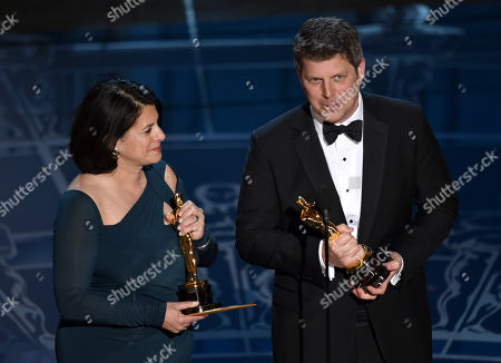 Anna Pinnock, left, and Adam Stockhausen accept the award for best production design for â?œThe Grand Budapest Hotelâ?? at the Oscars, at the Dolby Theatre in Los Angeles