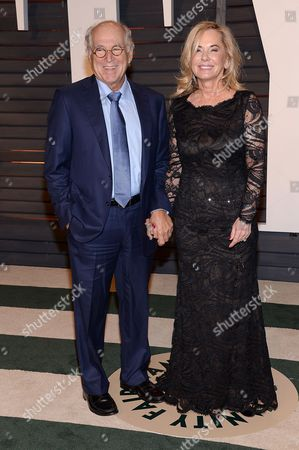 Jimmy Buffett, left, and Jane Slagsvol arrive at the 2015 Vanity Fair Oscar Party, in Beverly Hills, Calif