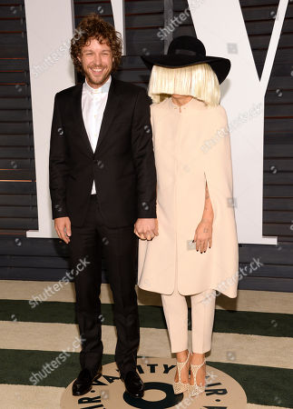 Erik Anders Lang, left, and Sia arrive at the 2015 Vanity Fair Oscar Party, in Beverly Hills, Calif