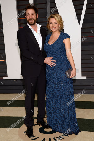 Noah Wyle, left, and Sara Wells arrive at the 2015 Vanity Fair Oscar Party, in Beverly Hills, Calif