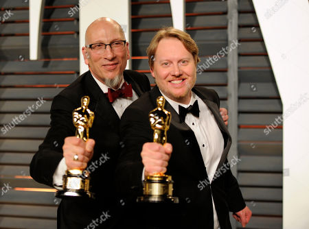 Roy Conli, left, and Don Hall pose backstage with their award for best animated feature film for Big Hero 6 arrives at the 2015 Vanity Fair Oscar Party, in Beverly Hills, Calif