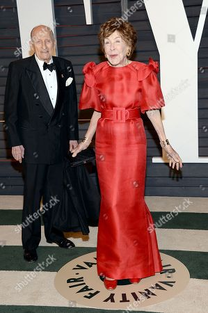 Betsy Bloomingdale, right, and a guest arrive at the 2015 Vanity Fair Oscar Party, in Beverly Hills, Calif