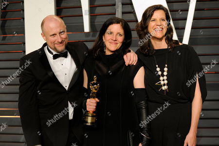 Dirk Wilutzky, from left, Laura Poitras, and guest arrive at the 2015 Vanity Fair Oscar Party, in Beverly Hills, Calif