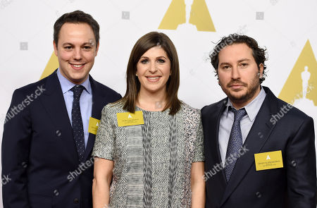 From left, Ido Ostrowsky, Nora Grossman and Teddy Schwarzman arrive at the 87th Academy Awards nominees luncheon at the Beverly Hilton Hotel, in Beverly Hills, Calif