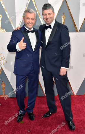 Stock Picture of Den Tolmor, left, and Evgeny Afineevsky arrive at the Oscars, at the Dolby Theatre in Los Angeles