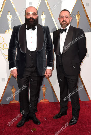 Paco Delgado, left, and Bernardo Corachan arrives at the Oscars, at the Dolby Theatre in Los Angeles