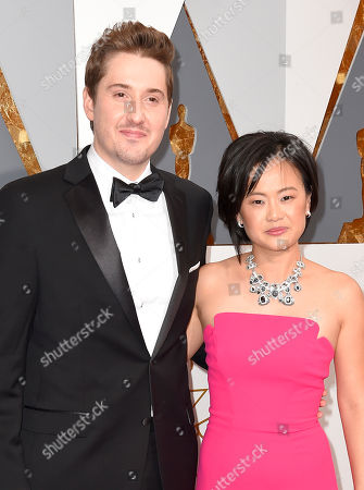 Duke Johnson, left, and Rosa Tran arrive at the Oscars, at the Dolby Theatre in Los Angeles
