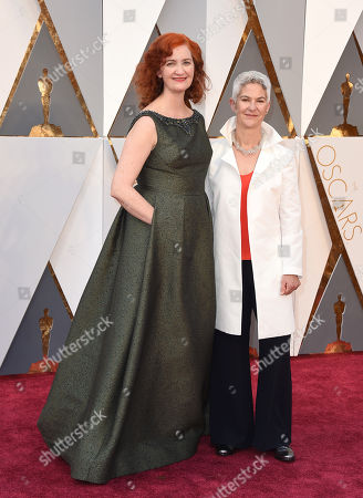 Stock Image of Emma Donoghue, left, and Chris Roulston arrive at the Oscars, at the Dolby Theatre in Los Angeles