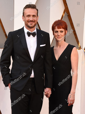 Jason Segel, left, and Alexis Mixter arrive at the Oscars, at the Dolby Theatre in Los Angeles