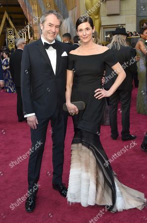 Carter Burwell, left, and Christine Sciulli arrive at the Oscars, at the Dolby Theatre in Los Angeles
