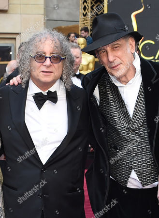 Hank Corwin, left, and Edward Lachman arrive at the Oscars, at the Dolby Theatre in Los Angeles