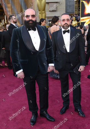 Paco Delgado, left, and Bernardo Corachán Garcia arrive at the Oscars, at the Dolby Theatre in Los Angeles
