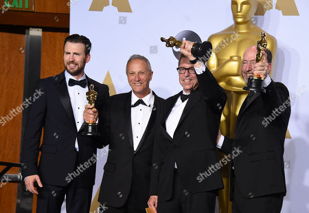 Chris Evans, from left, pose in the press room with the winners of the award for best sound mixing for Mad Max: Fury Road, Ben Osmo, Gregg Rudloff and Chris Jenkins at the Oscars, at the Dolby Theatre in Los Angeles