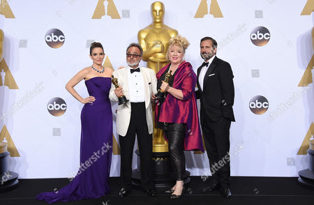 Tina Fey, left, and Steve Carell, right, pose in the press room with Colin Gibson, second left, and Lisa Thompson, winners of the award for best production design for Mad Max: Fury Road, at the Oscars, at the Dolby Theatre in Los Angeles
