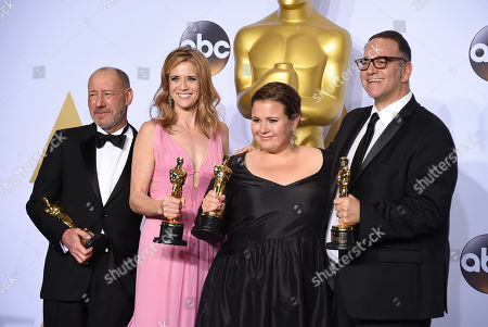 Steve Golin, from left, Blye Pagon Faust, Nicole Rocklin and Michael Sugar, winners of the award for best picture for Spotlight pose in the press room at the Oscars, at the Dolby Theatre in Los Angeles