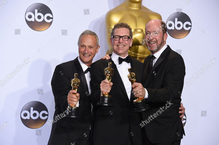 Ben Osmo, from left, Gregg Rudloff and Chris Jenkins, winners of the award for best sound mixing for Mad Max: Fury Road, pose in the press room at the Oscars, at the Dolby Theatre in Los Angeles