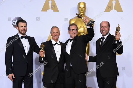 Stock Image of Chris Evans, from left, poses in the press room with the winners of the award for best sound mixing for Mad Max: Fury Road, Ben Osmo, from second left, Gregg Rudloff and Chris Jenkins at the Oscars, at the Dolby Theatre in Los Angeles