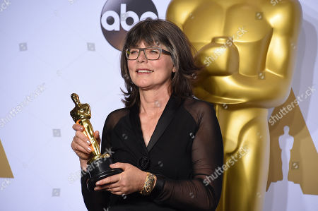 Margaret Sixel poses with the award for best film editing for Mad Max: Fury Road in the press room at the Oscars, at the Dolby Theatre in Los Angeles