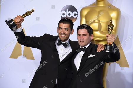 Gabriel Osorio Vargas, left, and Pato Escala pose with the award for best animated short film for Bear Story in the press room at the Oscars, at the Dolby Theatre in Los Angeles