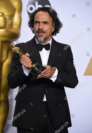 Alejandro G. Inarritu poses in the press room with the award for best director for The Revenant at the Oscars, at the Dolby Theatre in Los Angeles