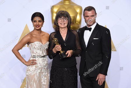 Priyanka Chopra, left, and Liev Schreiber, right, pose in the press room with Margaret Sixel, winner of the award for best film editing for â?oeMad Max: Fury Roadâ??, at the Oscars, at the Dolby Theatre in Los Angeles