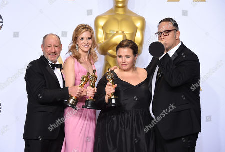 Steve Golin, from left, Blye Pagon Faust, Nicole Rocklin and Michael Sugar, winners of the award for best picture for â?oeSpotlightâ?? pose in the press room at the Oscars, at the Dolby Theatre in Los Angeles
