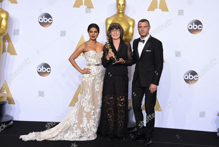 Priyanka Chopra, left, and Liev Schreiber, right, pose in the press room with Margaret Sixel, winner of the award for best film editing for Mad Max: Fury Road, at the Oscars, at the Dolby Theatre in Los Angeles