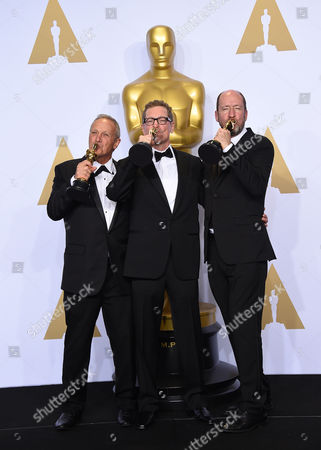 Stock Photo of Ben Osmo, from left, Gregg Rudloff and Chris Jenkins, winners of the award for best sound mixing for Mad Max: Fury Road, pose in the press room at the Oscars, at the Dolby Theatre in Los Angeles