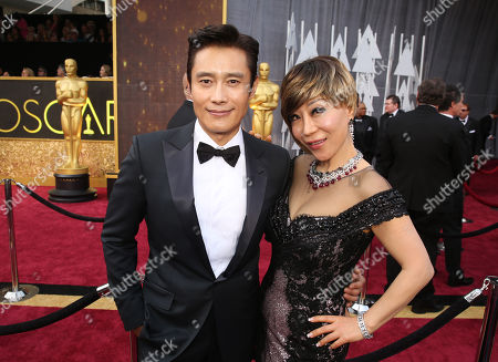 Byung-hun Lee, left, and Sumi Jo arrive at the Oscars, at the Dolby Theatre in Los Angeles
