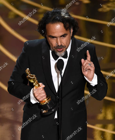 Alejandro G. Inarritu accepts the award for best director for The Revenant at the Oscars, at the Dolby Theatre in Los Angeles